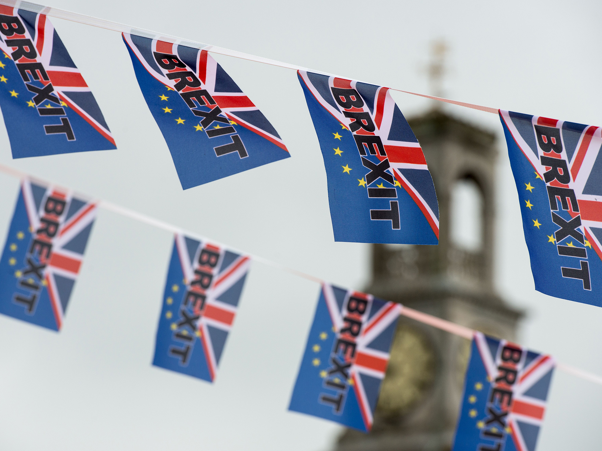 Pro-Brexit flags fly from a fishing boat moored in Ramsgate on June 13, 2016. Britain's opposition Labour Party today scrambled to make the case for Europe to its members as world stock markets slipped amid concern over a British exit from the EU in a knife-edge referendum next week. / AFP / CHRIS J RATCLIFFE (Photo credit should read CHRIS J RATCLIFFE/AFP/Getty Images)