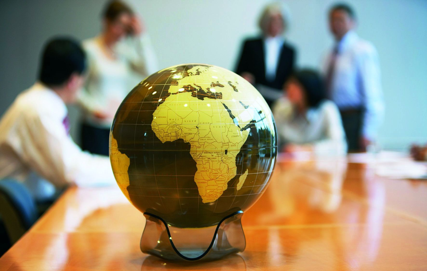 Globe on a Conference Table --- Image by © Rob Melnychuk/Corbis