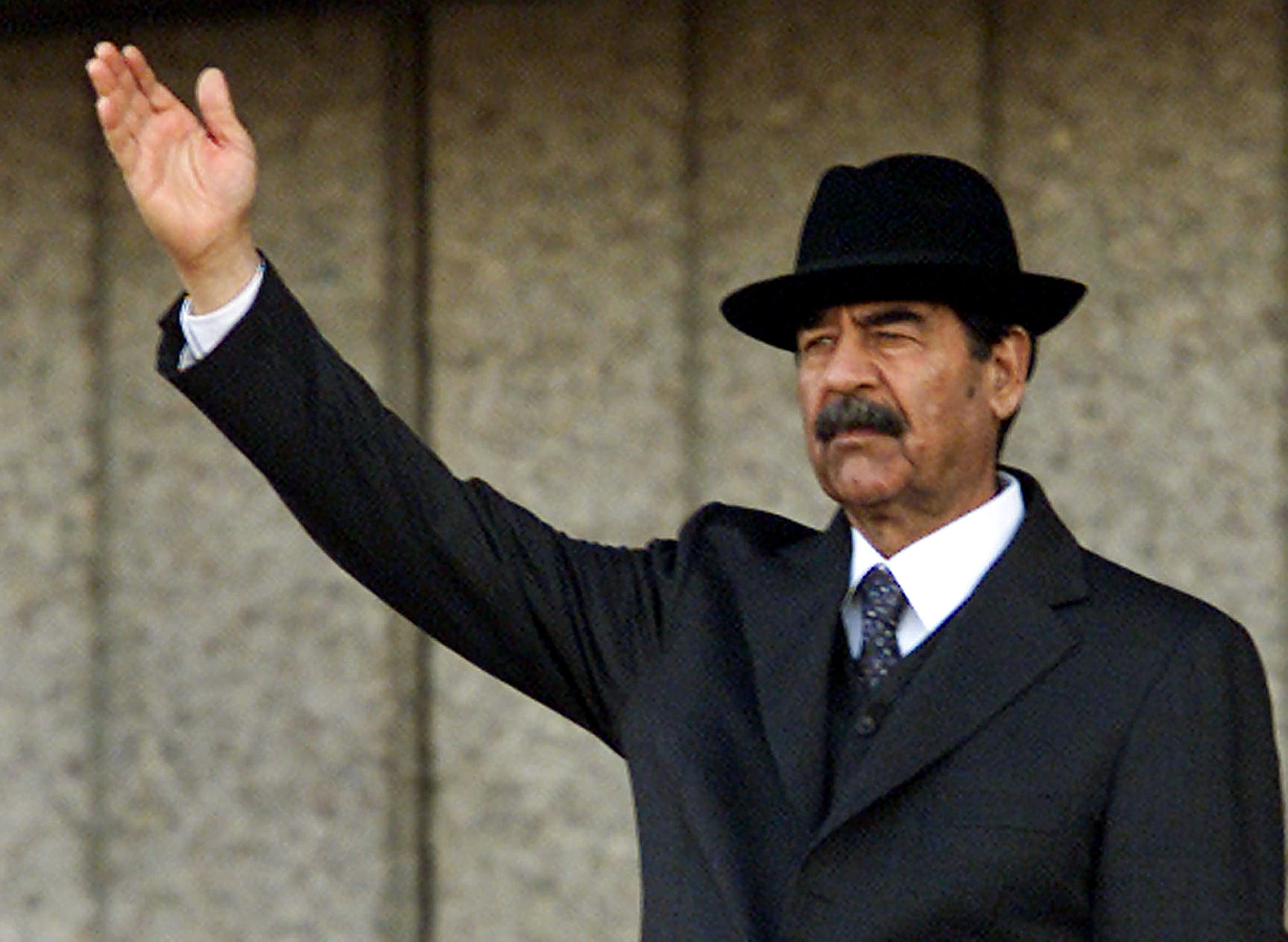 reuters - saddam - December 31, 2001 file photo of Iraqi President Saddam Hussein firing shots in air. Iraqi President Saddam Hussein apologised to the Kuwaiti people on Saturday dECEMBER 7, 2002 for his 1990-1991 occupation and urged them to struggle against foreign armies.